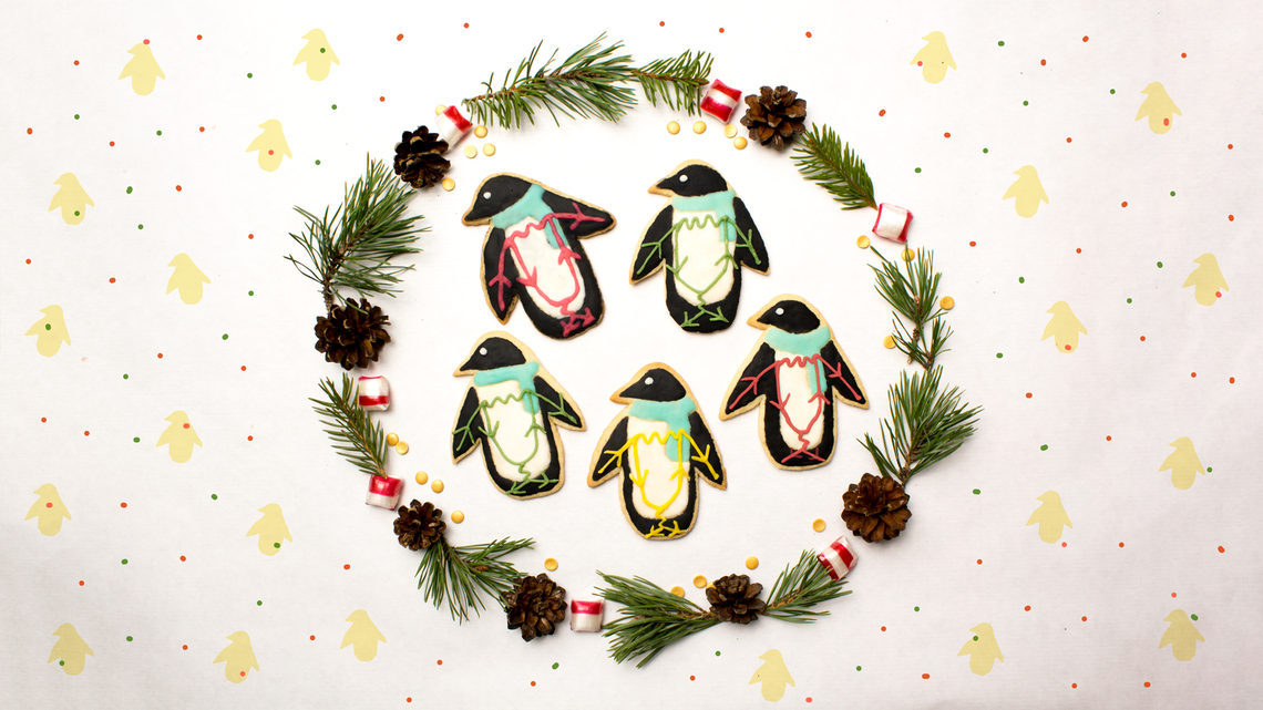 Penguin cookies, inside wreath with polka dot background