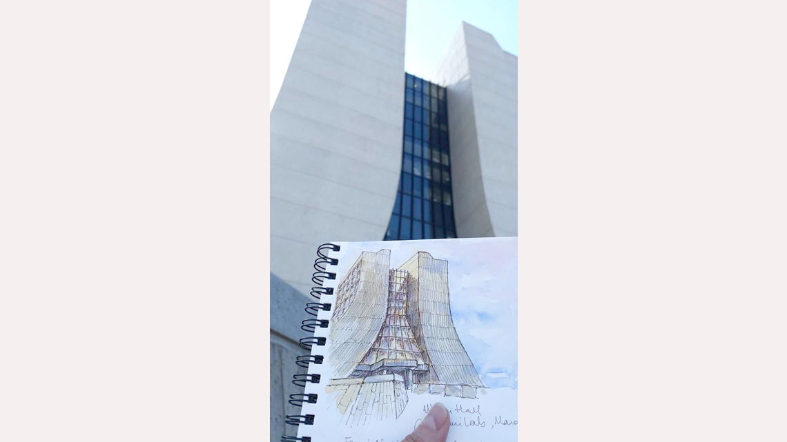 Drawing of Fermilab's Wilson Hall held up next to Wilson Hall