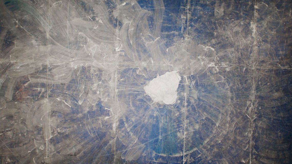 Overhead photograph of the pile of white sand left at the center of the blueprint