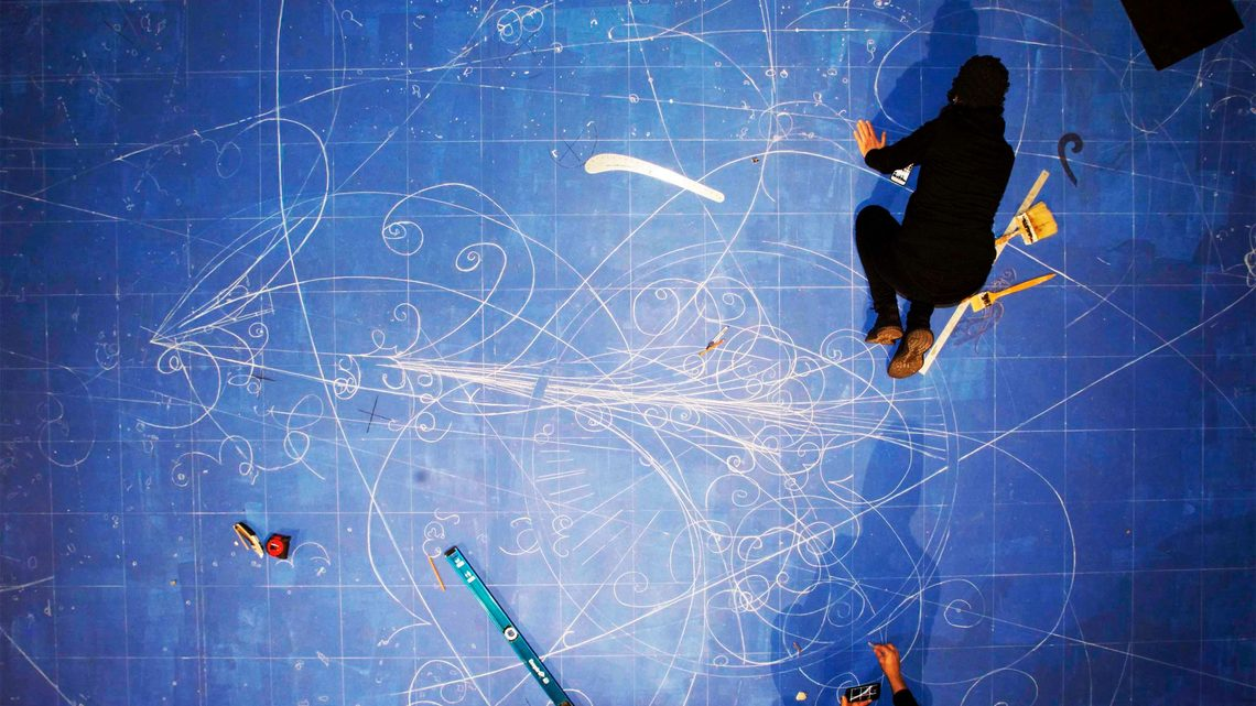 Overhead photograph of artists creating the blueprint
