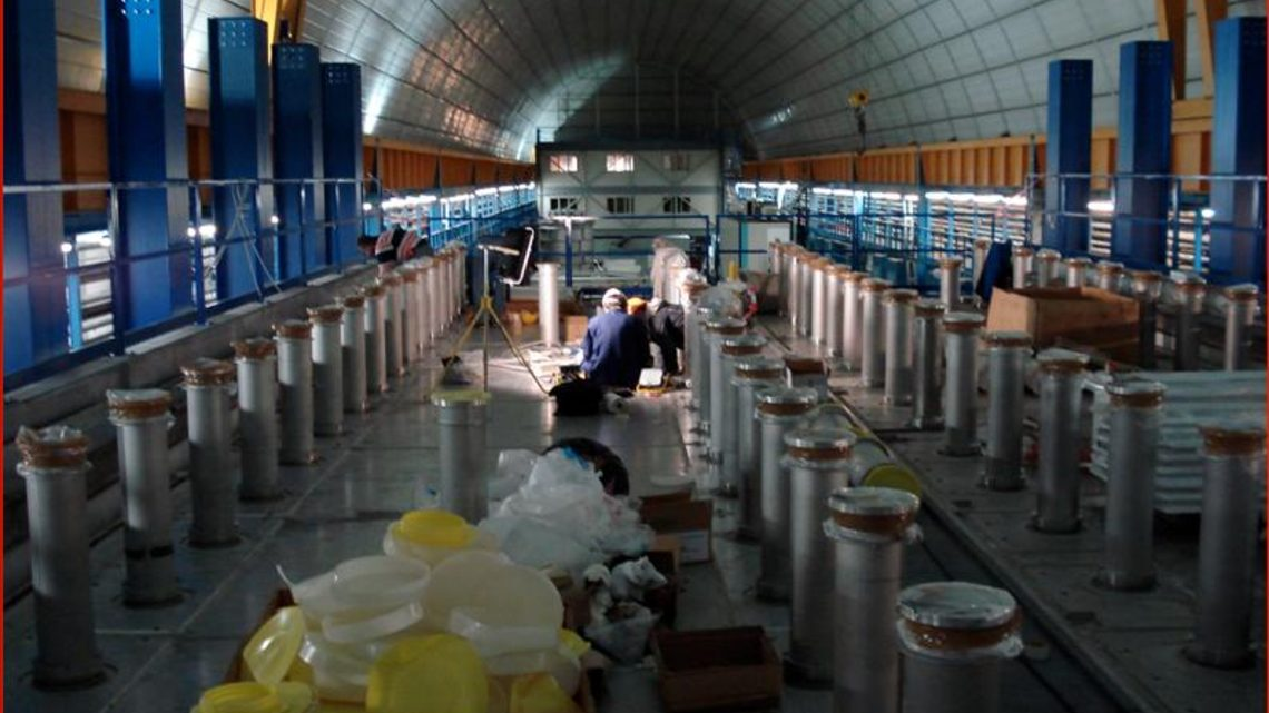 Photograph of scientists installing the ICARUS detector at Gran Sasso
