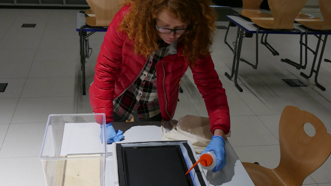 Photo of Ruth Jarman making a cloud chamber at CERN