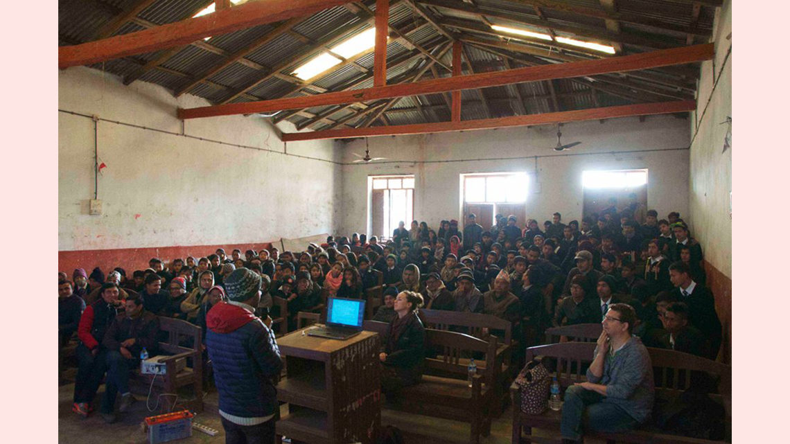 Photo of an auditorium full of students in Sindhuli