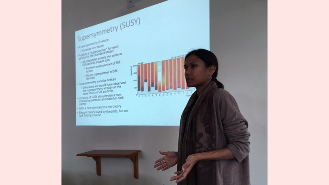 Photo of woman giving a presentation about supersymmetry