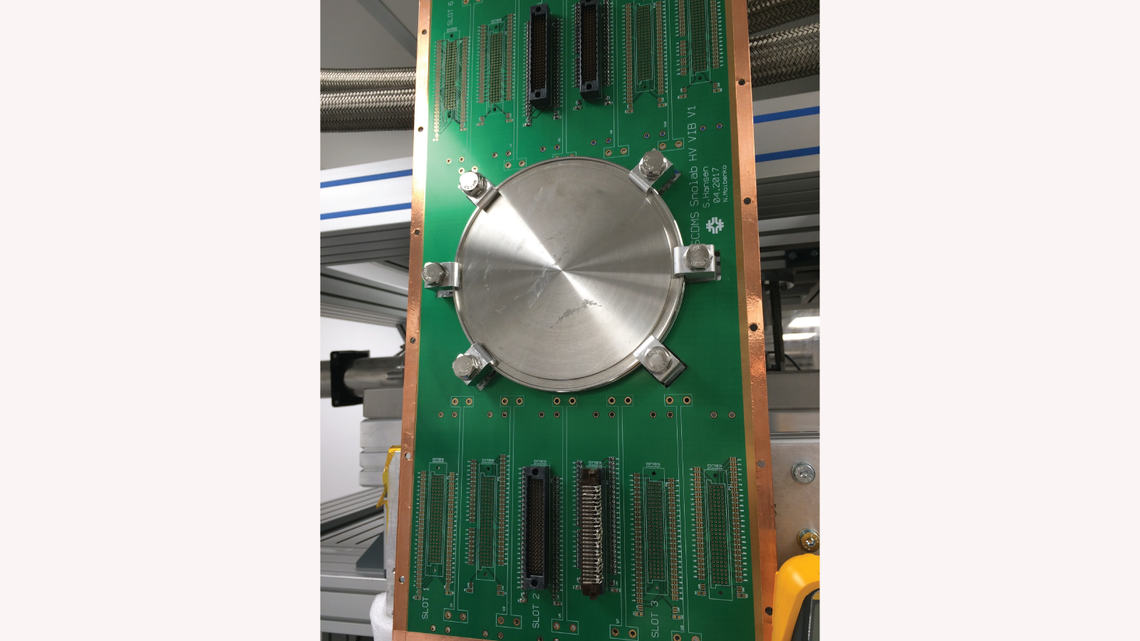 High-density vacuum interface board developed at Fermi National Accelerator Laboratory for the readout of cryogenic detectors.
