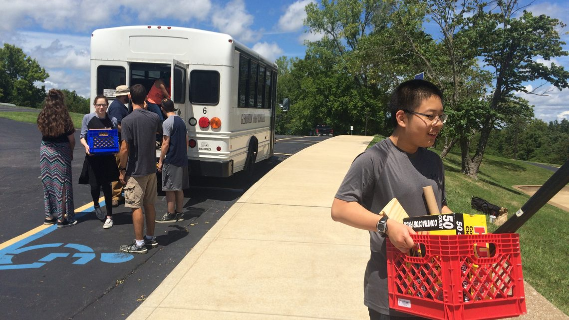 Photo of Glenbrook North High School students unloading bus