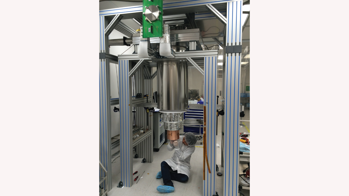 SLAC's Tsuguo Aramaki is completing the assembly of the dilution fridge test facility in Building 33 at SLAC.