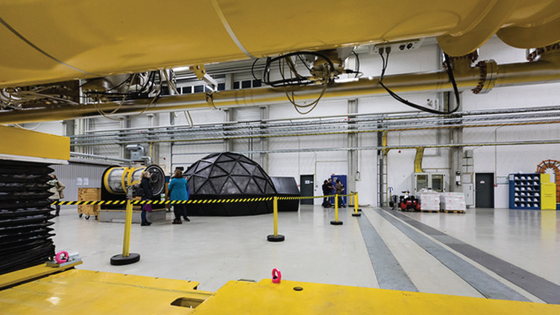 Photo of yellow and grey machinery in industrial space