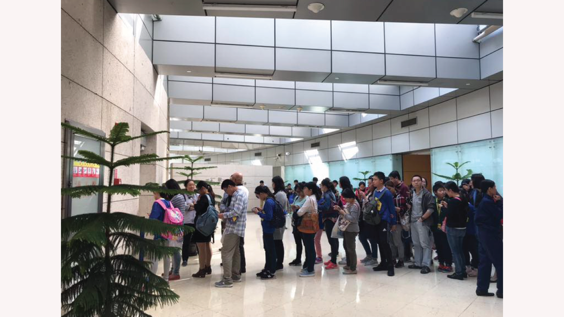 Visitors line up outside the Dark Matter Day event in Shanghai.