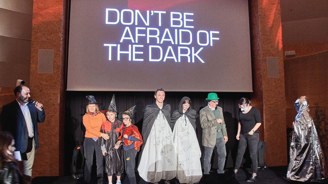 Photo of some creative participants dressed up in costumes related to dark matter