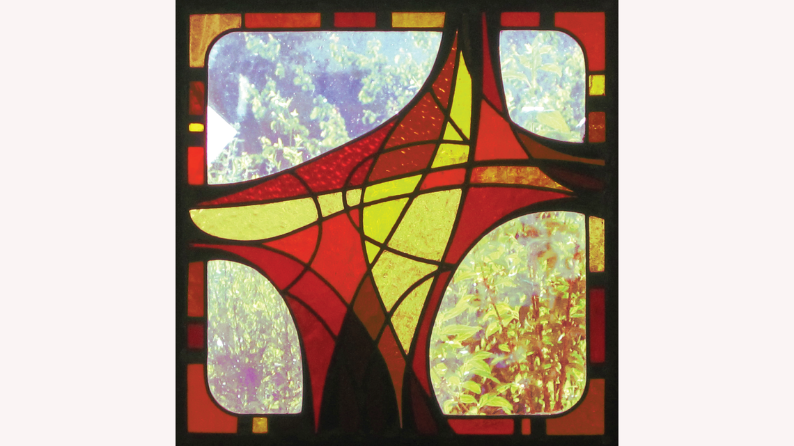 Curved lines stained glass piece in red, yellow, and black