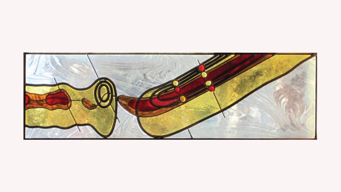 Stained glass piece inspired by the MiniBoone in red, orange, and yellow
