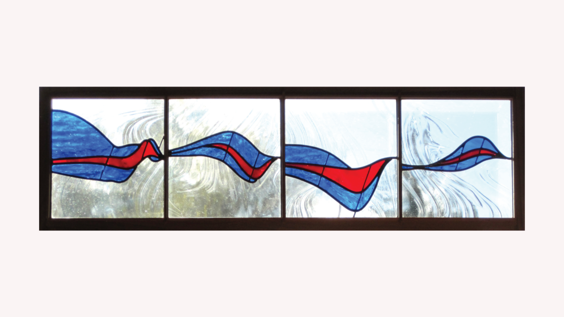 Stained glass piece inspired by Quarks and Gluons in red and blue