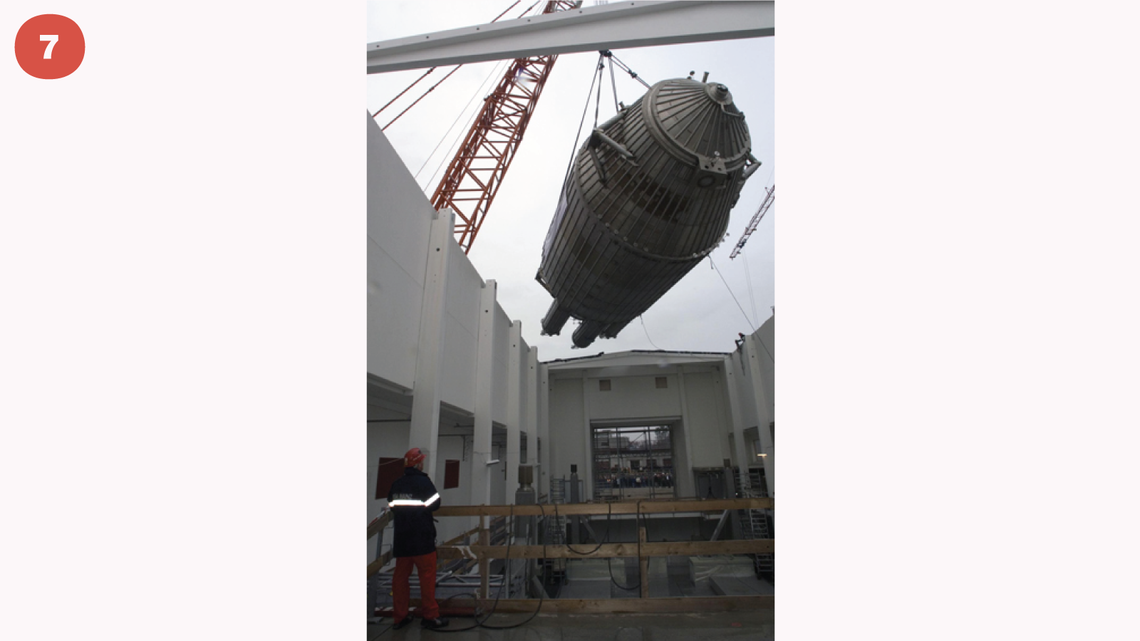 Photo of crane, reassembled at the research center, lifting the instrument to its final position through an open roof