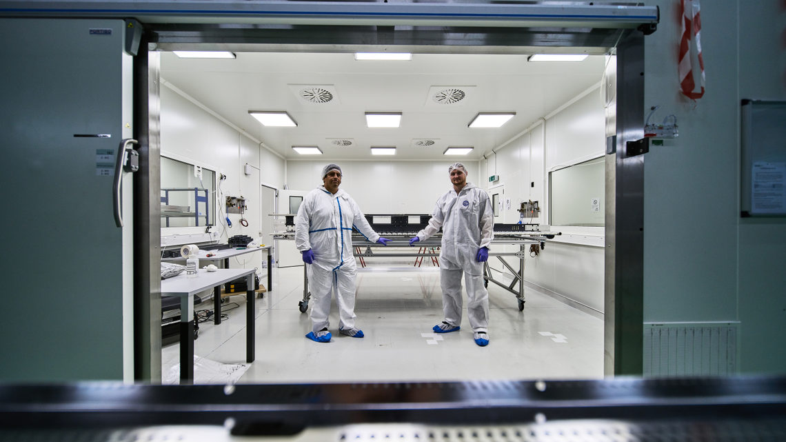 Researchers in a clean room