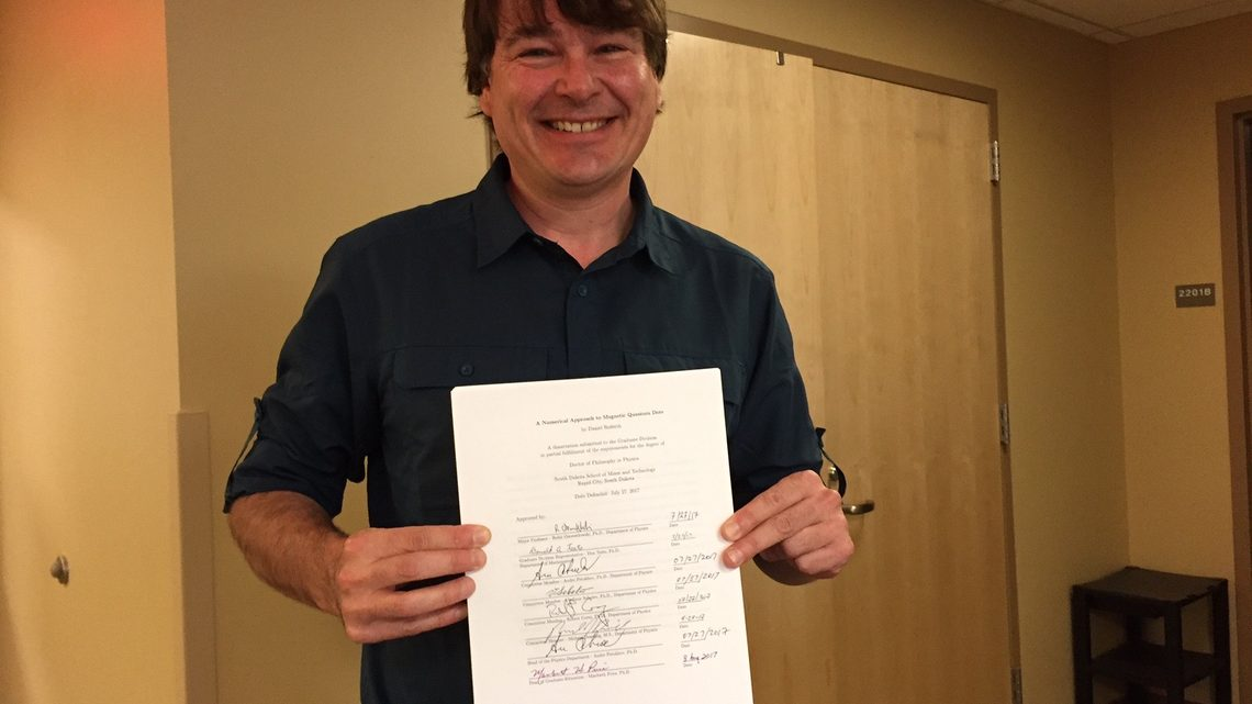 Dan Rederth hands in his dissertation