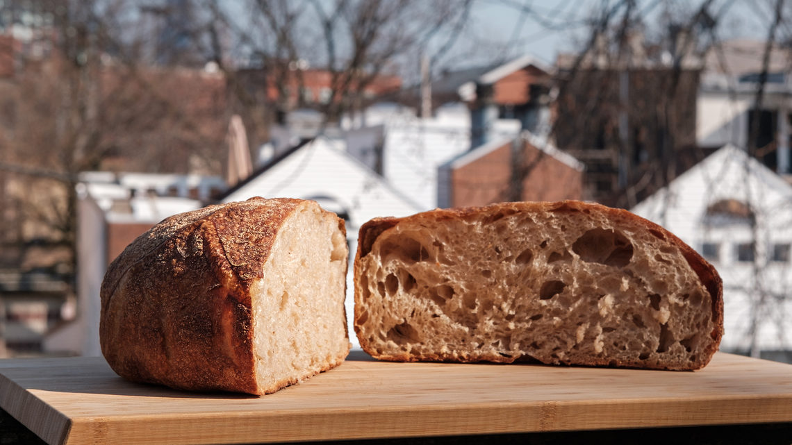 A sliced boule with Chicago in the background