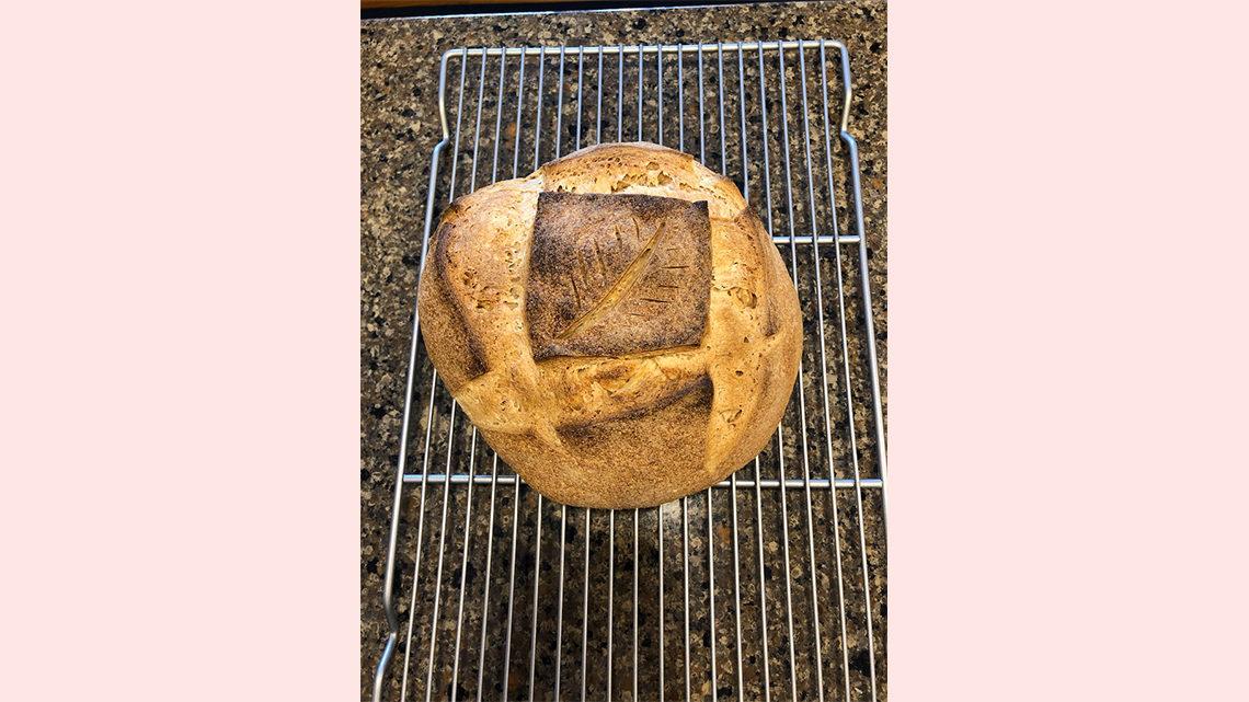 A decorated sourdough boule