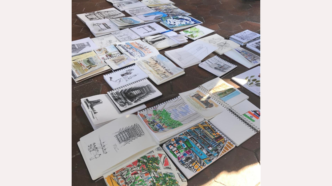 Sketchbooks arrayed on the ground in Wilson Hall
