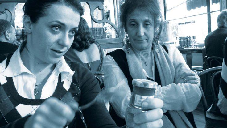 Experimental physicist Maria Spiropulu, left, illustrates ideas for Liz Lerman over brunch in Geneva.