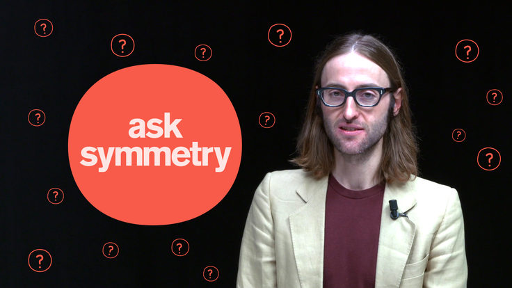 """Photo of James Lead with """"Ask symmetry"""" for Why do objects feel solid? article"""