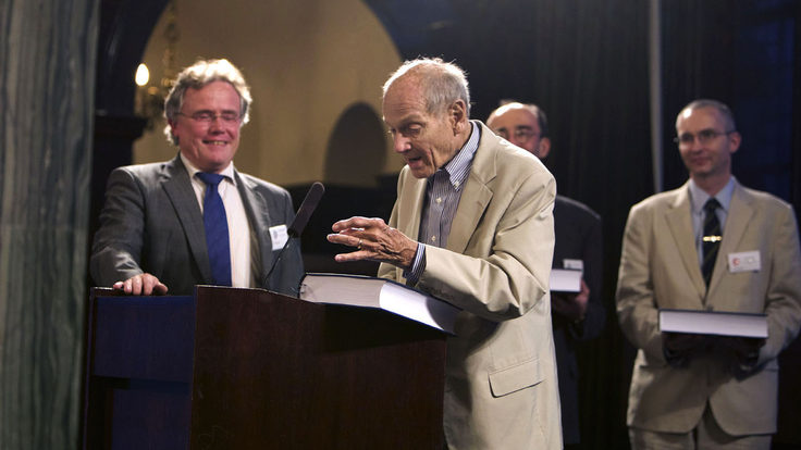 Photo of man at podium with B Book