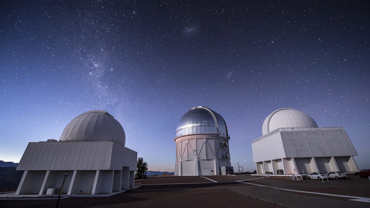 Photograph of telescopes under a starry sky