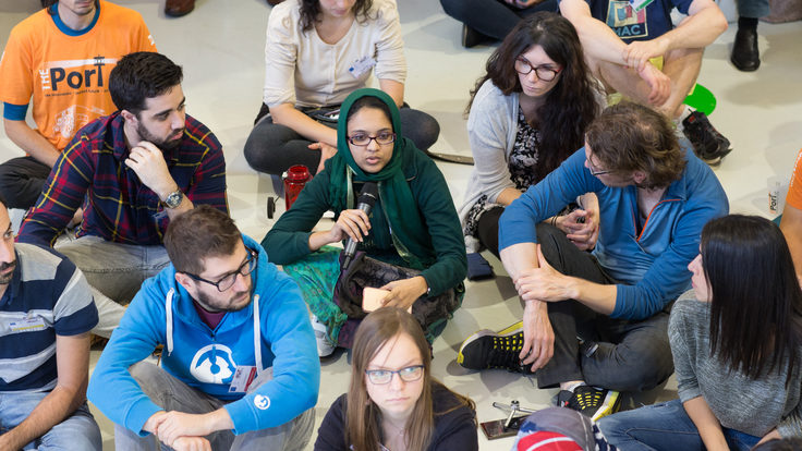 Group of students sitting on the floor talking
