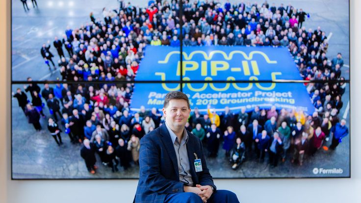 David Ibbett in front of a PIP-II background