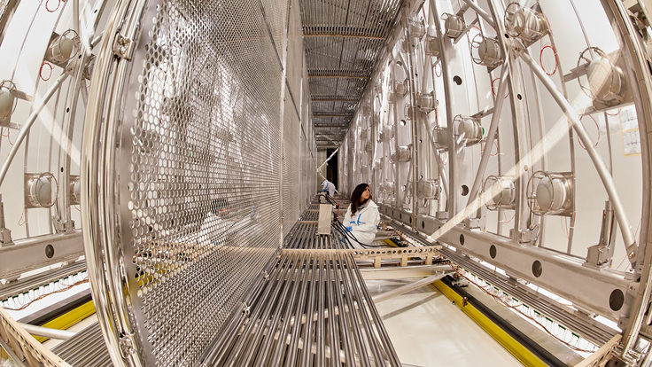 Scientists work inside the empty ICARUS detector