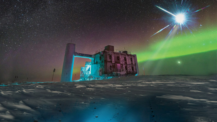 Artistic rendering of the IceCube Lab at the South Pole with a bright flash in the sky.
