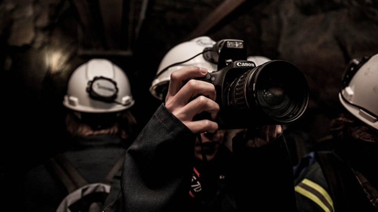 Photo of person with camera underground