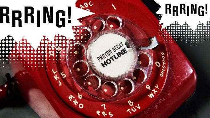 """Photo of old red dial telephone that says """"Rrring!"""""""