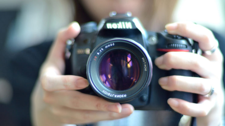 Image of person holding a camera