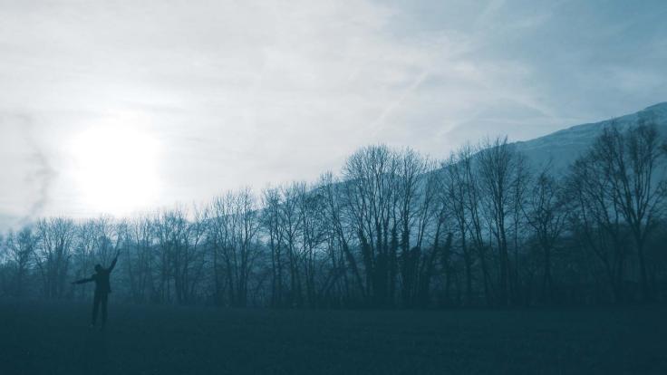 Dancer Ben Wegman blends into the evening fog on the CERN campus